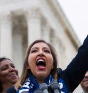 Eliana Fernandez, som omfattas av Daca, under en protest i Washington DC i november. Alex Brandon / TT NYHETSBYRÅN