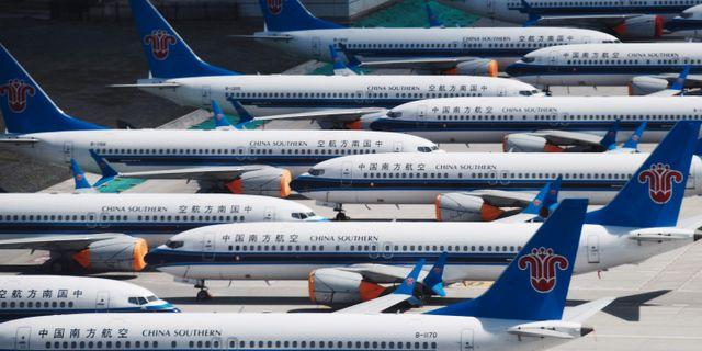 Plan av modellen Boeing 737 Max står parkerade på en flygplats i Kina.  GREG BAKER / AFP