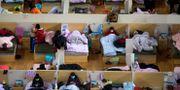 Smittade patienter på ett tillfälligt sjukhus i Wuhan i Kina. Xiao Yijiu / TT NYHETSBYRÅN