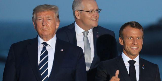 Trump och Macron samlas med de andra för ett gruppfoto. LUDOVIC MARIN / AFP