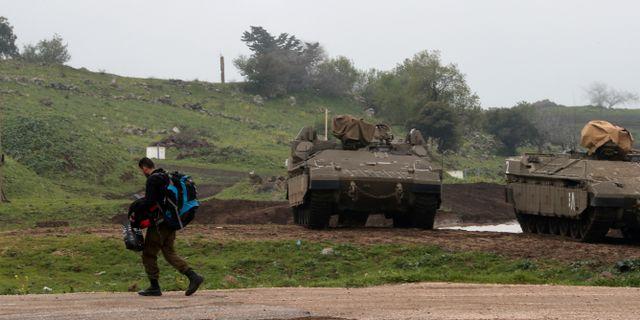 En israelisk militär i det ockuperade Golanområdet.  Ammar Awad / TT NYHETSBYRÅN