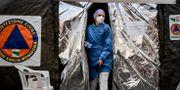 Sjukårdare utanför sjukhuset i Piacenza i norra italien. Claudio Furlan / TT NYHETSBYRÅN