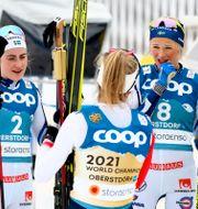 Frida Karlsson, Ebba Andersson och Therese Johaug. Matthias Schrader / TT NYHETSBYRÅN