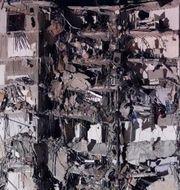 Delar av byggnaden som rasat.  Wilfredo Lee / TT NYHETSBYRÅN
