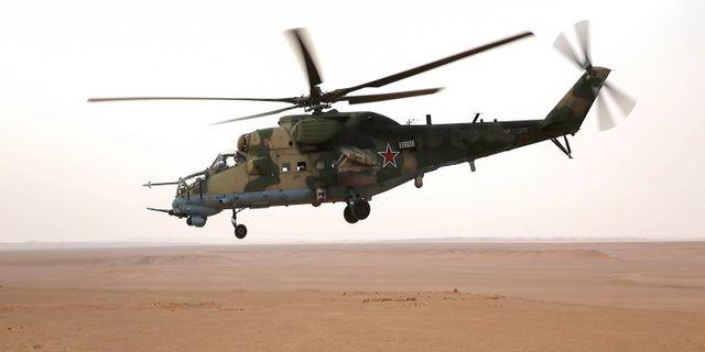 En rysk helikopter av typen MI-24 i Syrien i september förra året.  DOMINIQUE DERDA / France2