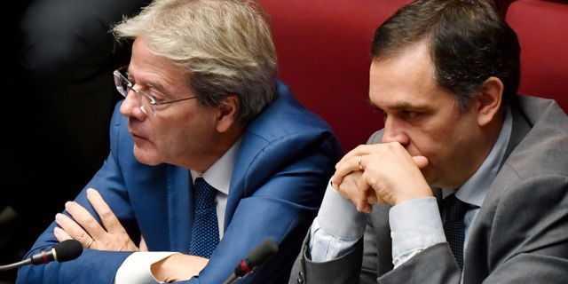 Paolo Gentiloni (t.v)  ANDREAS SOLARO / AFP