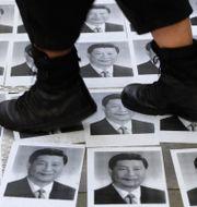 Bilder av president Xi Jinping. Vincent Thian / TT NYHETSBYRÅN
