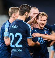 Malmö-spelarna firar. PETTER ARVIDSON / BILDBYRÅN