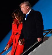 Donald Trump med sin hustru Melania Trump. NICHOLAS KAMM / AFP
