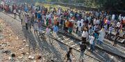 Ett tåg körde rakt in i en festival i indiska Amritsar på fredagen. Prabhjot Gill / TT NYHETSBYRÅN/ NTB Scanpix