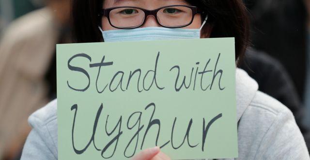 Protest för uigurers rättigheter/Arkivbild Lee Jin-man / TT NYHETSBYRÅN