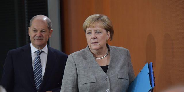 Finansminister Olaf Scholz och Angela Merkel.  TOBIAS SCHWARZ / AFP