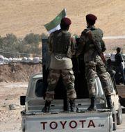 Styrkor stödda av Turkiet på väg mot Syrien. TT NYHETSBYRÅN