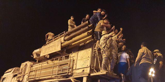 Regeringsstyrkor i huvudstaden Tripoli. MAHMUD TURKIA / TT NYHETSBYRÅN