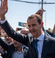 Bashar al-Assad under ceremonin. Hassan Ammar / TT NYHETSBYRÅN