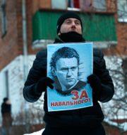 En anhängare till Aleksej Navalnyj. Pavel Golovkin / TT NYHETSBYRÅN