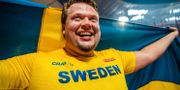 Daniel Ståhl firar VM-guldet. JOEL MARKLUND / BILDBYRÅN
