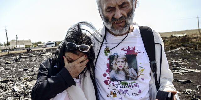 Jerzy Dyczynsk och Angela Rudhart-Dyczynski från Australien förlorade sin dotter Fatima när planet sköts ner. BULENT KILIC / AFP
