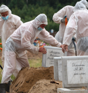 Vladimir Putin/offer för covid-19 begravs i Ryssland. TT