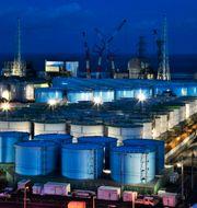 Vattentankar med kontaminerat vatten från Fukushima. TT NYHETSBYRÅN