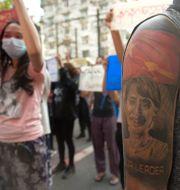 Demonstranter i Rangoon, 10 april. TT NYHETSBYRÅN