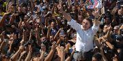 Högerkandidaten Jair Bolsonaro i ett hav av anhängare. Eraldo Peres / TT / NTB Scanpix