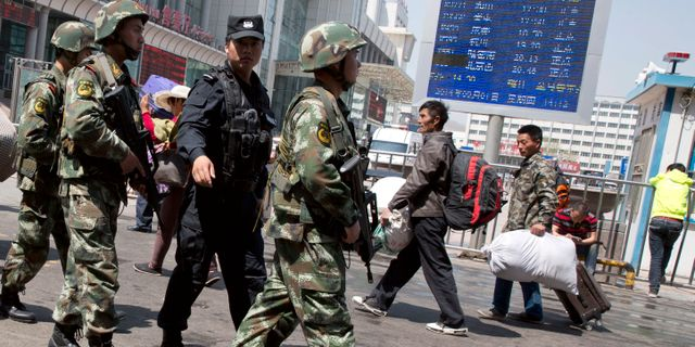 Militär i Xinjiang. Ng Han Guan / TT NYHETSBYRÅN