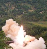 Bilder från ett nordkoreanskt missiltest i september.  TT NYHETSBYRÅN