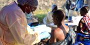 Sjukvårdspersonal i Kongo-Kinshasa. Olivia Acland / TT NYHETSBYRÅN