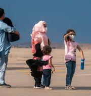 En afghansk familj väntar på att få lämna landet. Arkivbild. Andrea Comas / TT NYHETSBYRÅN
