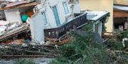 Ett hus som förstörts efter ett jordskred  i Österrike. STRINGER / FMT
