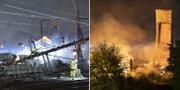 Räddningstjänsten bevakar under natten branden samtidigt som arbetet pågår vid en kontaktledning som fallit ner över tågspåren i närheten av branden. TT