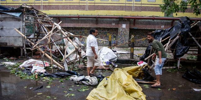 Människor i Kolkata.  Bikas Das / TT NYHETSBYRÅN
