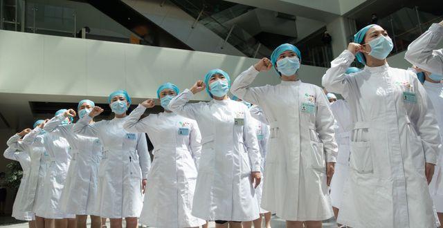 Illustrationsbild: Sjuksköterskor i Wuhan.  STR / TT NYHETSBYRÅN