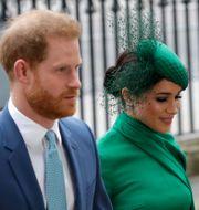 Prins Harry och hustrun Meghan Markle/Arkivbild Kirsty Wigglesworth / TT NYHETSBYRÅN