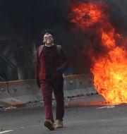 Bild från torsdagens protester.  Tatan Syuflana / TT NYHETSBYRÅN