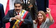 Arkivbild: Nicolás Maduro tillsammans med makan Cilia Flores.  Ariana Cubillos / TT NYHETSBYRÅN