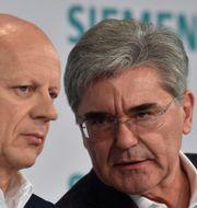 Vd oJe Kaeser and finanschef Ralf Thomas CHRISTOF STACHE / AFP