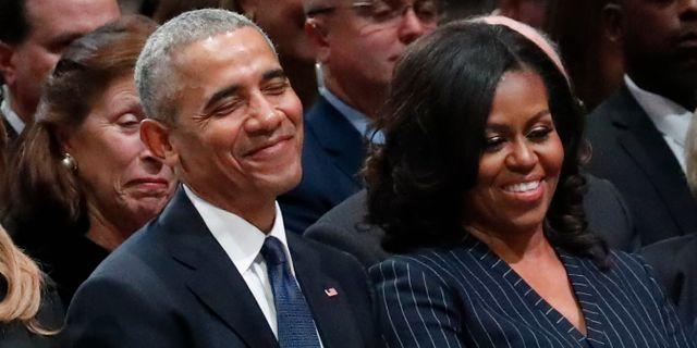 Barack och Michelle Obama. Arkiv. Alex Brandon / TT NYHETSBYRÅN