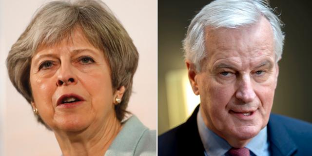 Theresa May och Michel Barnier.  TT
