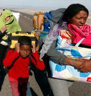 Flyktingar från Venezuela på gränsen mot Chile. Luis Hidalgo / TT NYHETSBYRÅN