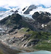 Smältande glaciär i Schweiz. Arkivbild. Matthew Kennedy / TT NYHETSBYRÅN/ NTB Scanpix