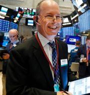 Illustrationsbild: Glad börsmäklare. Richard Drew / TT NYHETSBYRÅN