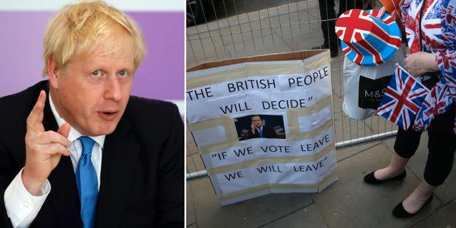 Boris Johnson och kvinna vid brexit-plakat.  AP/TT