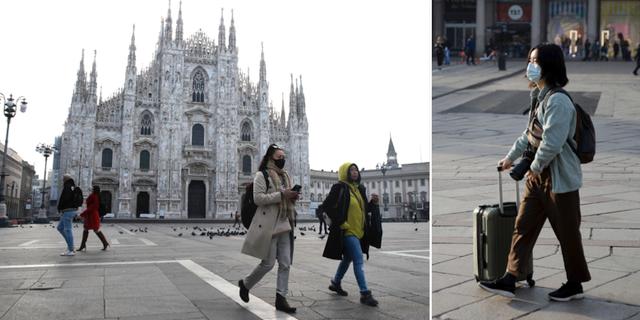 Människor bär ansiktsmasker framför Duomo di Milano, Milanosgotiskakatedral. TT