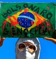 Bild från tidigare protester mot presidenten.  Eraldo Peres / TT NYHETSBYRÅN