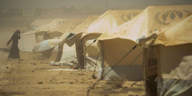 En kvinna i ett flyktingläger i en ökan i Jordan 2012. Clemens Bilan / TT NYHETSBYRÅN