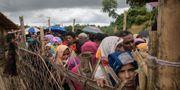 Rohingyer köar för mat i flyktinglägret Cox's Bazar  i Bangladesh. Arkivbild. ED JONES / AFP