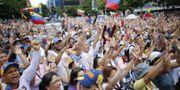Protester inför valet. Ariana Cubillos / TT / NTB Scanpix
