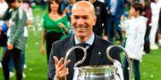 Zidane firar Reals Champions League-seger i maj. GENYA SAVILOV / AFP